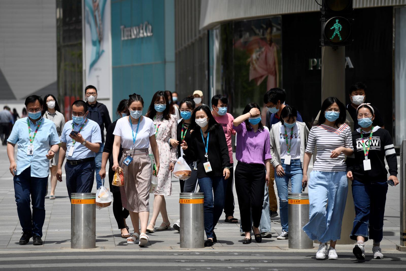 การระบาดครั้งใหม่ของโควิด-19 ในจีนแสดงสัญญาณว่าไวรัสกำลังเปลี่ยนไป